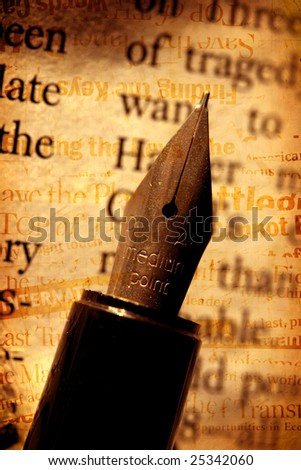 Old fashioned fountain pen with book - stock photo