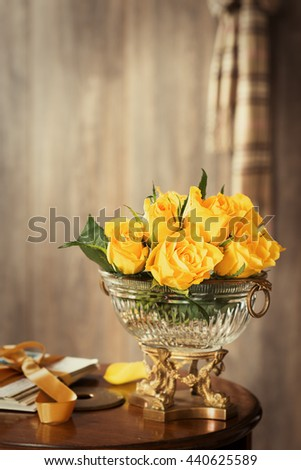 Old fashioned garden roses in antique vase - plenty of copy space