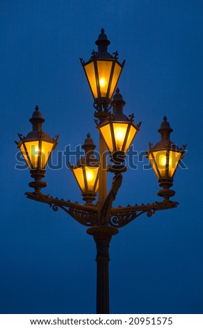 Old-fashioned glowing lantern against the night sky - stock photo