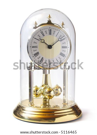 Old-fashioned gold clock with pendulum under glass - stock photo