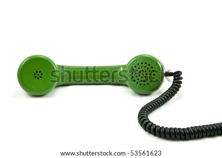 Old-fashioned green  telephone receiver with cord on white background - stock photo