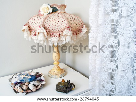Old fashioned lamp on the commode - stock photo