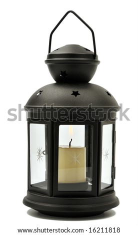 Old-fashioned lamp with candle inside isolated on white
