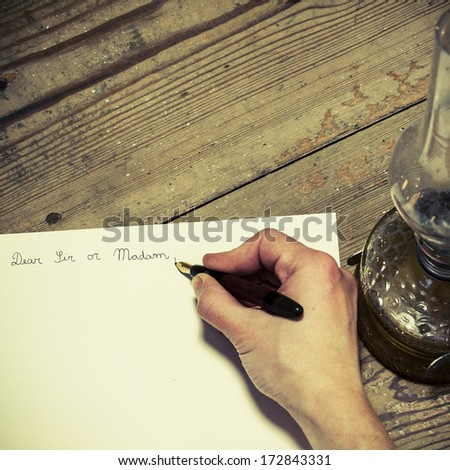 Old fashioned letter with a pen and lamp - stock photo