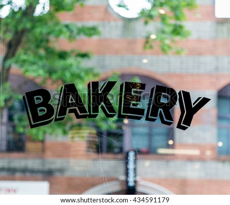Old fashioned lettering on a bakery window - stock photo