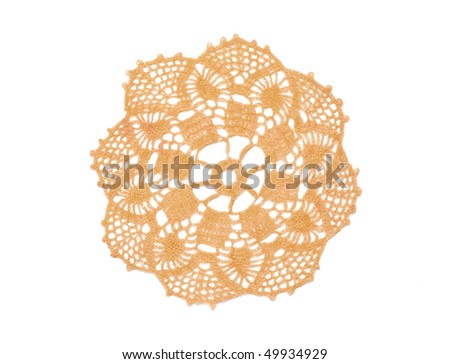 Old-fashioned little beige crocheted doily isolated in white. - stock photo