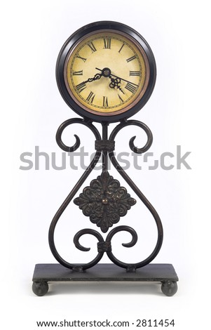 Old fashioned looking clock isolated on white - stock photo