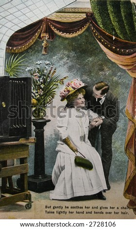 Old fashioned love, couple in photostudio- circa 1904 hand-tinted photograph