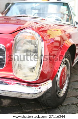 old-fashioned luxury red car - stock photo