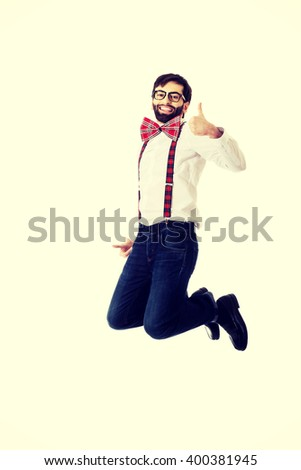 Old fashioned man wearing suspenders jumping. - stock photo