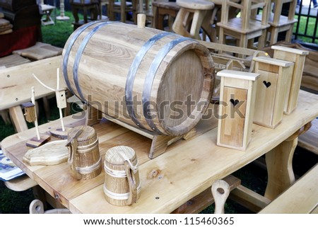 Old-fashioned, medieval wooden mug and barrel - stock photo