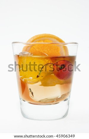 Old fashioned mixed drink on a white background - stock photo