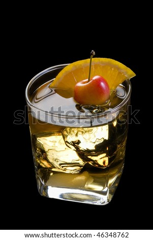 Old Fashioned mixed drink with orange slice, cherry and sugar cube garnish on black background with - stock photo