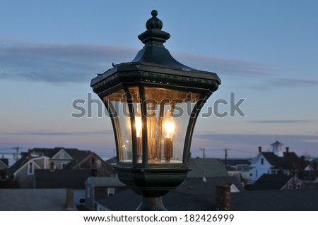 Old fashioned post lamp against the twilight sky in Provincetown