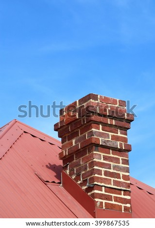 old fashioned red brick chimney on a roof top - stock photo