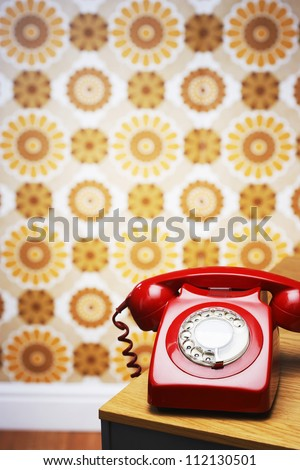 Old fashioned red telephone - stock photo