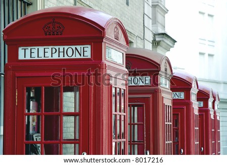 Old fashioned red telephone booths in London, United Kingdom - stock photo