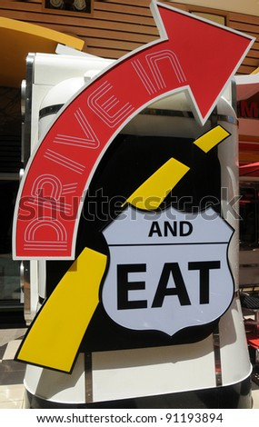 Old fashioned roadside restaurant sign (replica) - stock photo