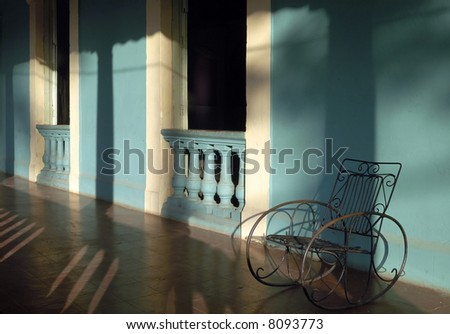 Old fashioned rocking chair at porch in Cuba - stock photo