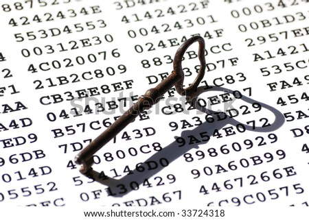 Old-fashioned rusty iron key on a sheet with encrypted data - stock photo