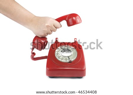 Old fashioned 1970's or 50's style red telephone - stock photo