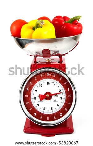 Old Fashioned scales with peppers and tomatoes - stock photo