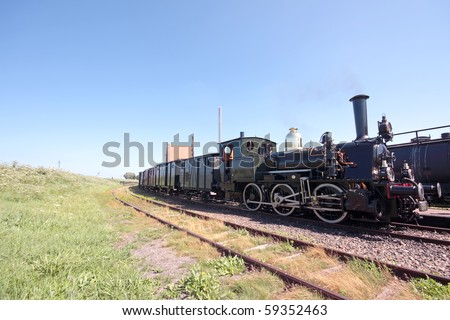 Old fashioned steam train running in the countryside from the Netherlands