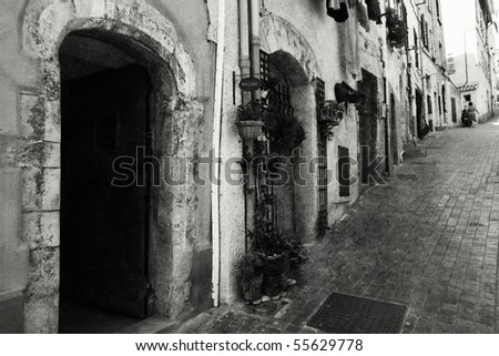 Old-fashioned street in Italy. Black in white image - stock photo