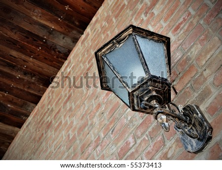 old-fashioned street lamp on the red brick wall