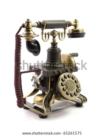 Old fashioned telephone isolated on white