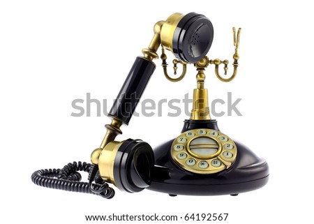 Old fashioned telephone isolated on white background. Studio work. - stock photo