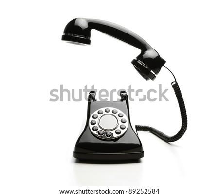 Old fashioned telephone on white background - stock photo