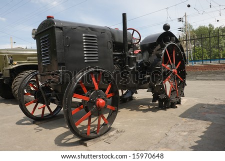 old fashioned tractor with iron wheel