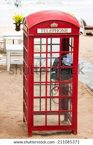 Old-fashioned traditional red public telephone booth - stock photo