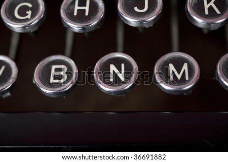 Old fashioned typewriter keys in a close up shot. The central focus is on the N - or No button - stock photo