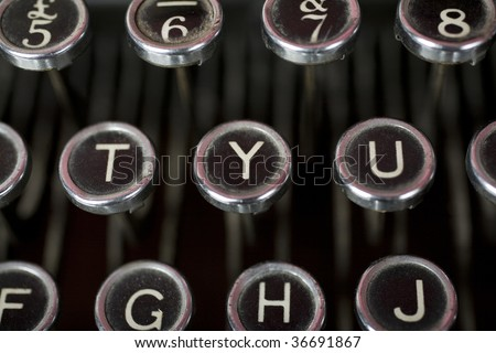 Old fashioned typewriter keys in a close up shot. The central focus is on the Y - or Yes button - stock photo