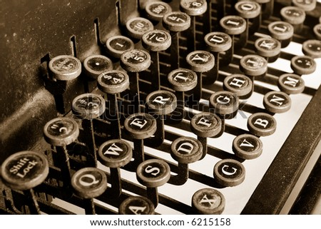 Old-fashioned typewriter with sepia cast and film grain - stock photo