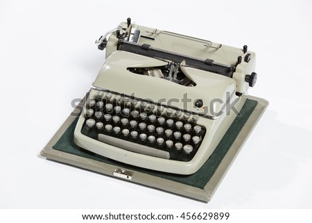Old fashioned, vintage typewriter isolated on white background with a blank sheet of paper inserted with space for a custom message