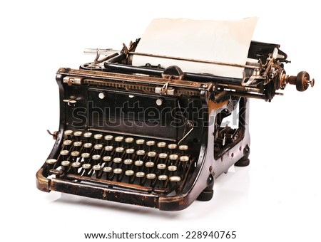 old fashioned, vintage typewriter with a blank sheet of paper  - stock photo