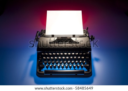 old fashioned, vintage typewriter with a blank sheet of paper inserted - stock photo