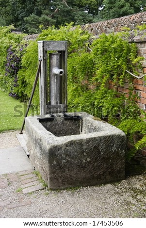 old fashioned water pump in a garden