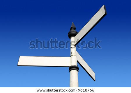 Old fashioned 3 way blank direction signpost.