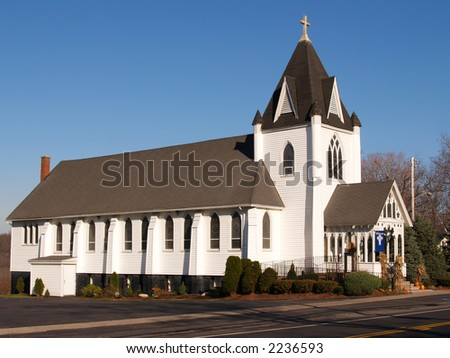 Old-fashioned white church with arched windows - stock photo