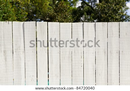 Old fashioned whitewashed board fence ready for your message or graffiti. - stock photo