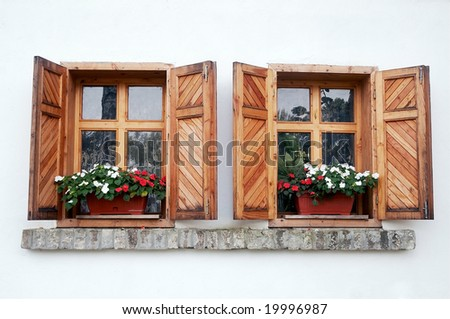 Old-fashioned window on white wall - stock photo