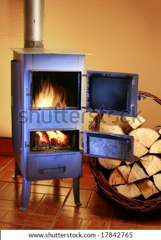 Old fashioned wood burning stove - stock photo