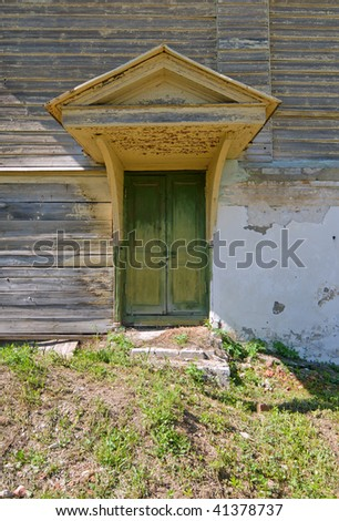 old fashioned wooden closed door with awning - stock photo