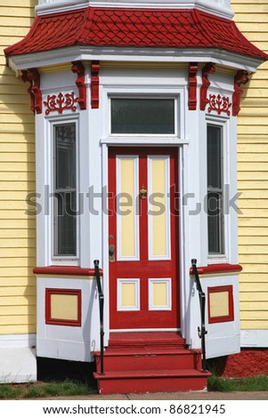 Old fashioned wooden door on a Victorian era home. - stock photo