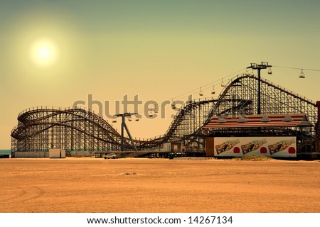 old fashioned wooden rollercoaster at dusk fall - stock photo