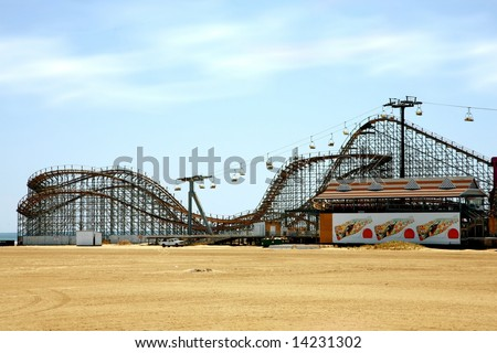 old fashioned wooden rollercoaster on the beach - stock photo